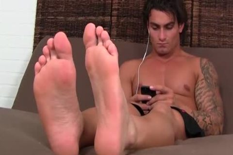 wild brunette hair Vlad With Tattoos Shows Off His good Toes