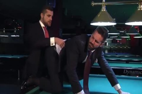 Two guys In Suits Meet In A Bar